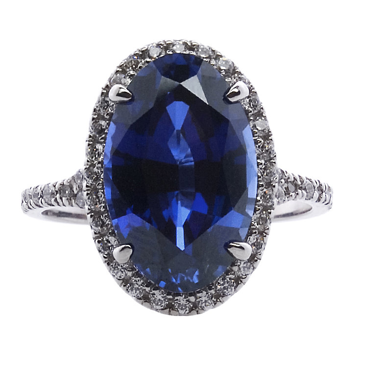 CARAT* 9ct White Gold & Blue Oval Stone Cut Ring Size O - Product number 3905659