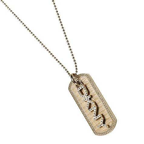 gold coloured dog tag